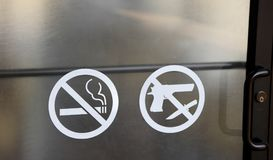 Gun, Knives, Weapons and Smoking Prohibited Stock Photos