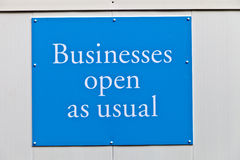 Sign: Businesses open as usual Royalty Free Stock Photo