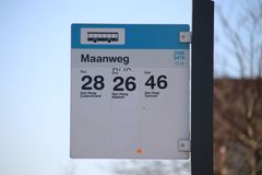 Sign at a busstop in The Hague where busses of HTM and Arriva will stop at the maanweg in industrial zone Binckhorst. Sign at a busstop in The Hague where royalty free stock photo