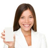 Sign card woman on white. Sign card woman holding paper like mobile phone or smart phone. Empty paper business card with copy space. Beautiful young Royalty Free Stock Photography