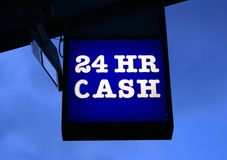 Sign of a cash machine or ATM. 24 Hr Cash sign. Sign directing public to a cash machine Stock Photo