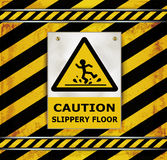 Sign caution blackboard caution slippery floor Stock Photos