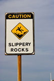 Sign caution slippery rocks Royalty Free Stock Image