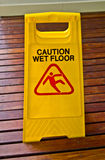 A sign, caution wet floor. A warning sign, caution wet floor stock image