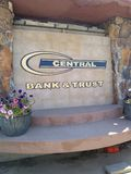 Sign for Central Bank & Trust. With built in bench stock photos