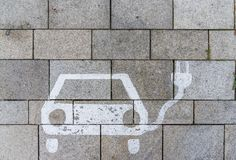 Sign for charging station on parking lot with concrete pavement. And joints stock photos
