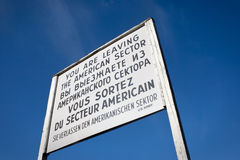 Sign at Checkpoint Charlie that divided berlin. Sign at Checkpoint Charlie that divided east and west Berlin during the cold war, Germany royalty free stock image