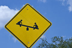 Sign - Children on TeeterTotter Stock Photo