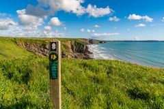 Sign: Cliffs kill keep to the path English & Welsh Stock Image
