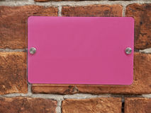 Sign. Close up of blank pink sign on outside wall Royalty Free Stock Photos