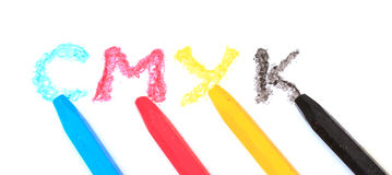 Sign of the CMYK from pastel crayons Stock Images