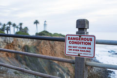 Sign on coastline to be aware of danger Royalty Free Stock Photography