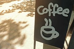 Sign at coffee shop with hot coffee icon Royalty Free Stock Images