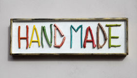Sign with colorful wooden letters forming word Royalty Free Stock Photography