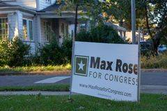 A sign for congressional candidate Max Rose on the sidewalk in Staten Island royalty free stock photo
