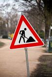 Sign and construction traffic signs. Sign and traffic sign at a construction site Royalty Free Stock Image