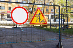 Sign of construction works in yard. Sign of construction works of laying pipes in the city yard Stock Photo