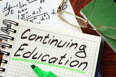 Sign continuing education written in a notepad Stock Images