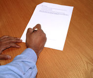 Sign the contract. Asian businessman signing a contract royalty free stock image