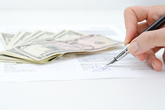 Sign a contract or agreement with a pen. Sign a contract or agreement with a fountain pen Stock Photos