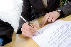 Sign a contract Royalty Free Stock Image