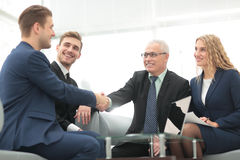 In a sign of cooperation, the partners shake hands after signing Royalty Free Stock Photo
