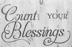 Sign count your blessing. Black and white sign count your blessing Stock Photography