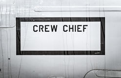 Sign of Crew Chief on side of military airplane. Royalty Free Stock Photos