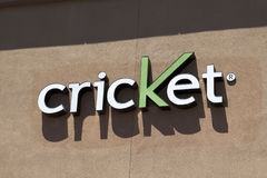 Sign at Cricket wireless cellular retail store. Lighted sign above Cricket wireless retail store. Cricket is a smaller player in the cellular phone carrier stock photo
