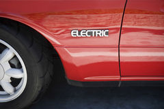 Sign On Cropped Red Electric Car Stock Images