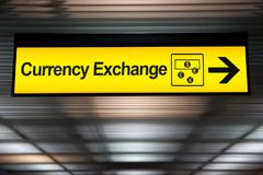 Sign currency exchange at the airport with money currency icon. And arrow for direction to currency exchange booth counter service for tourist stock image