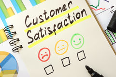 Sign customer satisfaction. Sign customer satisfaction on a page of notebook Royalty Free Stock Photos