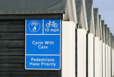 Sign, Cycle with Care. Cycle sign on a seaside promenade royalty free stock image