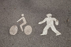 The sign cyclist and pedestrian on the pavement Stock Images