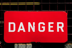 Sign of danger. Red danger sign on a gate Stock Photos