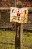 A sign of danger in Auschwitz. A sign of danger in the death camp in Auschwitz royalty free stock photography