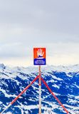 Sign `Danger of avalanches` on top of the mountain Hohe Salve. Ski resort Soll, Tyrol. Sign , `Danger of avalanches` on top of the mountain Hohe Salve. Ski Royalty Free Stock Images