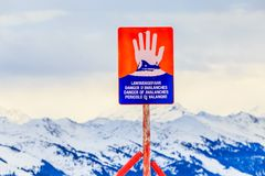 Sign `Danger of avalanches` on top of the mountain Hohe Salve. Ski resort Soll, Tyrol. Sign , `Danger of avalanches` on top of the mountain Hohe Salve. Ski Royalty Free Stock Photos