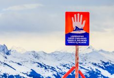 Sign `Danger of avalanches` on top of the mountain Hohe Salve. Ski resort Soll, Tyrol. Sign , `Danger of avalanches` on top of the mountain Hohe Salve. Ski Royalty Free Stock Image