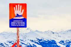 Sign `Danger of avalanches` on top of the mountain Hohe Salve. Ski resort Soll, Tyrol. Sign , `Danger of avalanches` on top of the mountain Hohe Salve. Ski Stock Photography