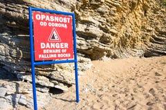 Sign Danger beware faling rocks on beach, Montenegro Stock Photography