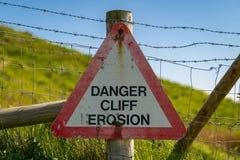 Sign: Danger cliff erosion stock photo