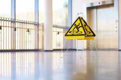 Sign danger corridor modern building Royalty Free Stock Image