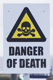 Sign, Danger of Death. Sign with skull and crossbones saying  Danger of Death Stock Photos
