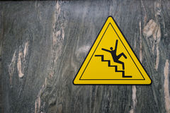 Sign of danger of falling stairs slip warning caution on marble stock image