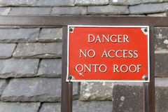 Sign: danger no access onto roof Stock Photos