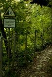 Sign `Dangerous trail, break!` Royalty Free Stock Photo