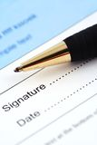 Sign and Date Here. Macro of a pen and signature page, shallow DOF royalty free stock photography