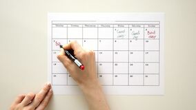 Sign the day in the calendar with a pen, draw a good bad day. 4k stock footage