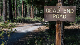 Sign for dead end road. A wood dead end road sign on a forest road royalty free stock photography